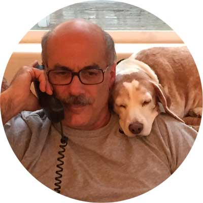 Dr. Paul Joannides and his assistant, Woody the beagle.