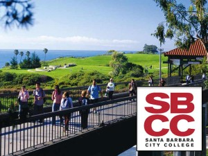 View of students walking on the campus of Santa Barbara City College with the ocean in the background and the insignia of Santa Barbara City College on the bottom right.