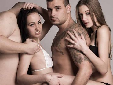 Image showing two couples intertwined in their underwear.