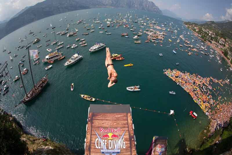 Cliffdiver soon after his leap from a platform taken with the fisheye lens.
