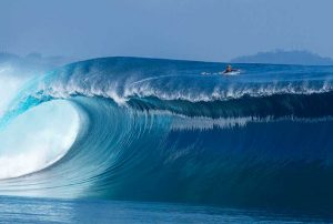 Surfer on top of a massive swell off the coast of Tasmania.