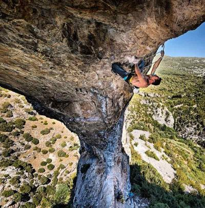 Rock climber from a spectacular perspective.