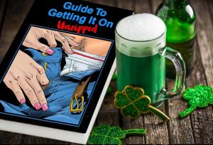 Picture of the Guide To Getting It On sitting next to a mug of green beer and shamrocks.