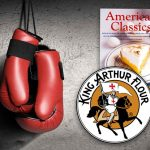 For banana bread cook off, boxing gloves hanging with logo from King Arthur Flour and the Cook's Illustrated American Classics cookbook