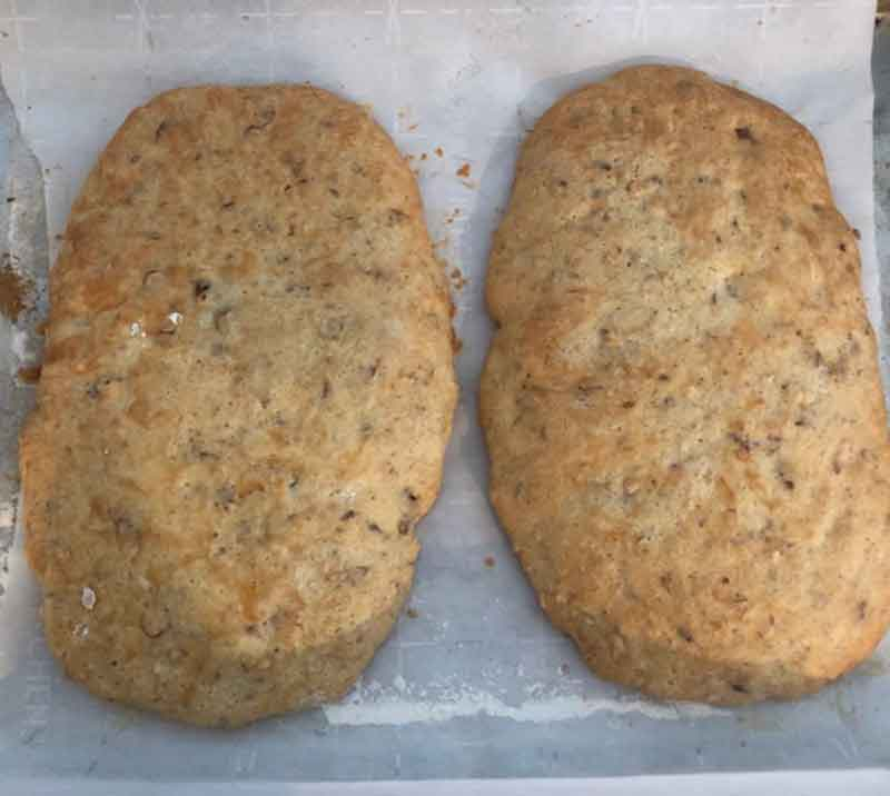 two loaves of biscotti after their first bake, before cooling and slicing.